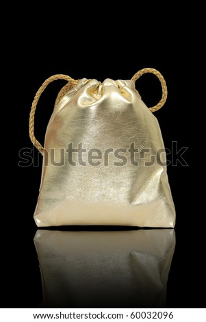 Gold bag in black background.,use for keep money or cosmetics - stock photo
