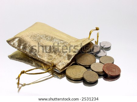 gold bag with coins on silver mirror background - stock photo