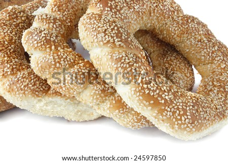 Gold bagel with sesame