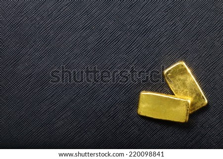 Gold bar put on old and vintage paper map represent the detail of city name and destination and concept idea of wealth.         - stock photo