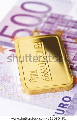Gold bars and Euro bank note - stock photo