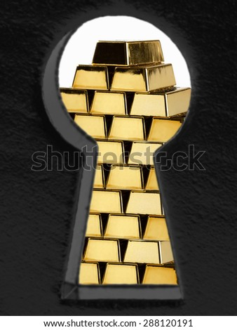 Gold bars that look through a lock - stock photo