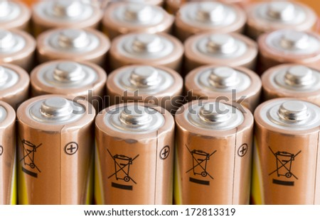 Gold Batteries in Rows with Silver Tops Closeup  - stock photo