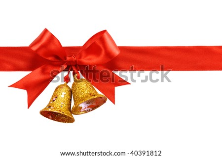 Gold bell and red satin ribbon bow, isolated on white. - stock photo