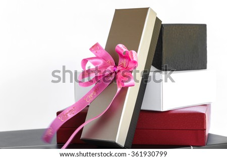 Gold black white and red gift box with pink ribbon bow , isolate on white background