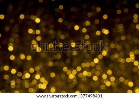 gold bokeh lights defocused. abstract background - stock photo