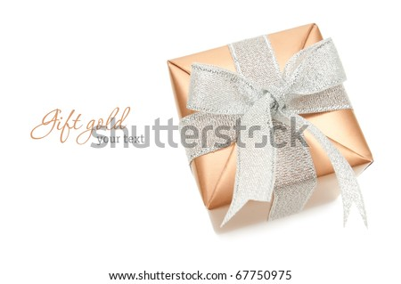Gold box with silver ribbon on white background. Copy-space - stock photo