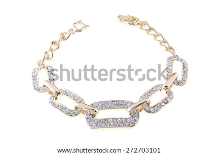 gold bracelet with diamonds on a white background - stock photo