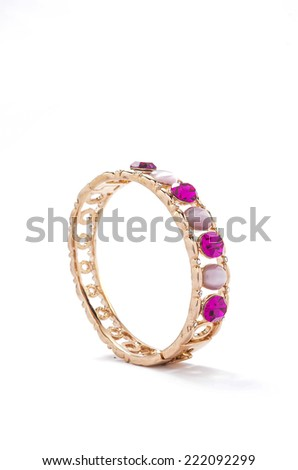 gold bracelet with pink stones on white background - stock photo