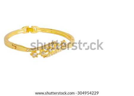 Gold bracelets adorned with diamonds. Fake jewelry. Clipping path in picture.