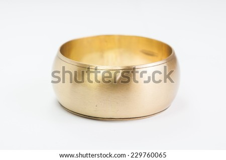 Gold bracelets on white background - stock photo