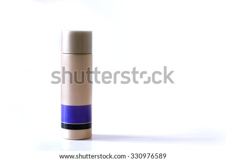 Gold Brown and purple plastic bottle for beauty cream isolated on white background, used for spa or beauty treatment - stock photo