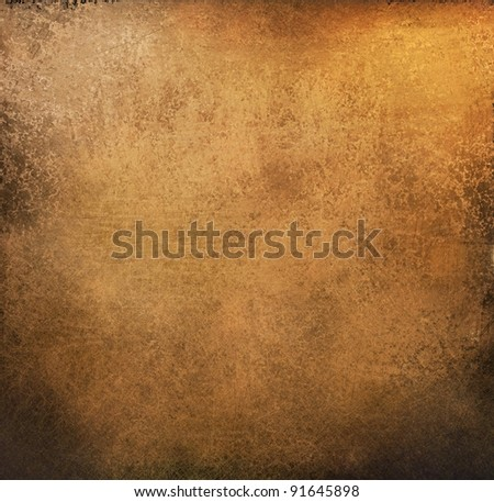 gold brown background paper with vintage grunge background texture with black scuffed edges and old faded antique design has copy space for ad brochure or announcement invitation, abstract background - stock photo