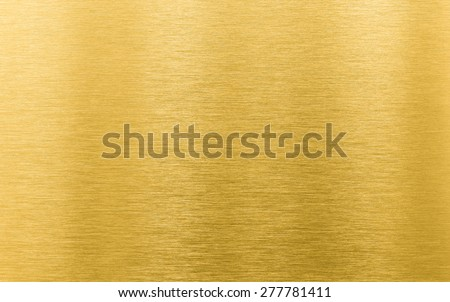 gold brushed metal texture or background - stock photo