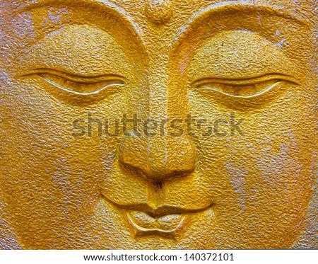 gold Buddha face - stock photo