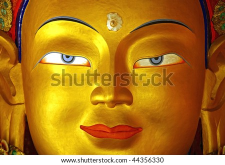 gold Buddha face - stock photo