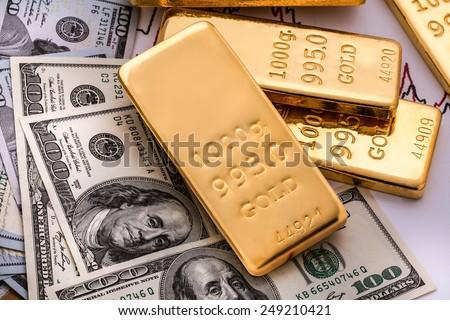 Gold bullion and money - stock photo