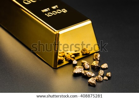 gold bullion and nuggets on a dark background - stock photo