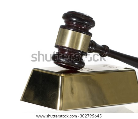 Gold bullion bar and gavel