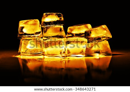 Gold bullion on a black background with reflection