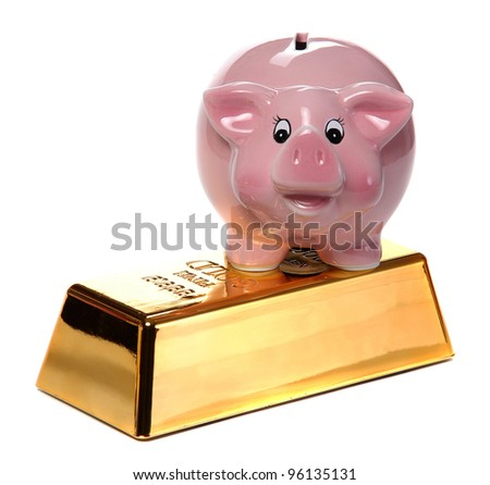 gold bullion with pink piggy bank - stock photo