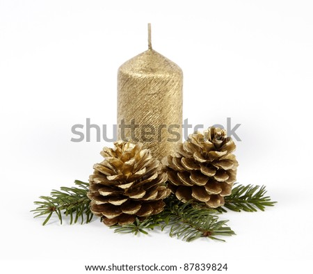 Gold candle with the twig of the spruce and cones - stock photo