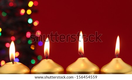 Gold candles with christmas lights