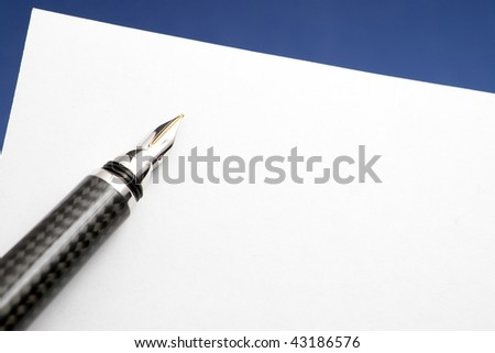 Gold Carbon Fiber Fountain Pen with Blank Paper. - stock photo