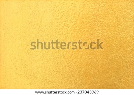 Gold cement wall texture background - stock photo