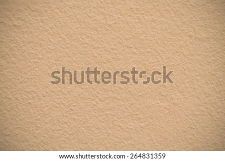 Gold cement wall texture used as background - stock photo