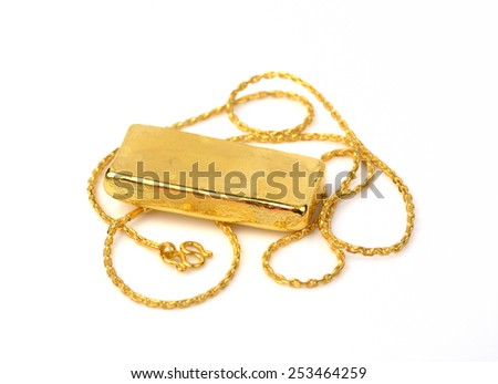 gold chain and  gold bar on a white background - stock photo