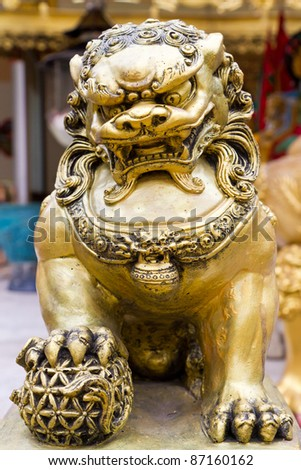 gold chinese lion in the temple