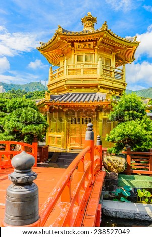 Gold Chinese pavilion at the park of Hong Kong - stock photo