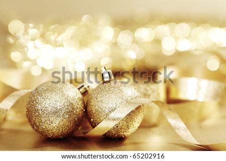 gold christmas ball on golden bokeh background - stock photo