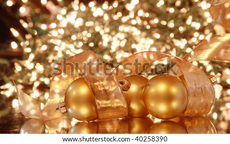 Gold Christmas balls and background with bokeh.