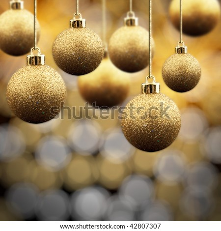 Gold Christmas balls on a multi coloured sparkling background - stock photo