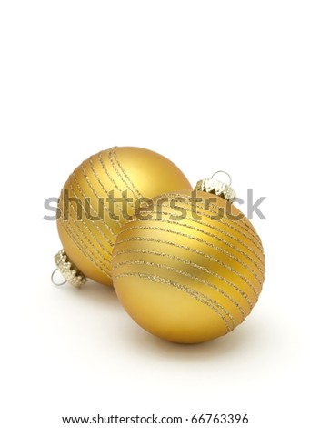 gold christmas balls on white - stock photo