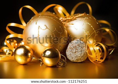 gold christmas balls with black background. gold - stock photo
