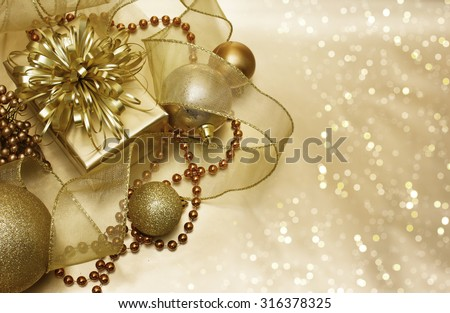 Gold Christmas decorations on a bokeh lights background