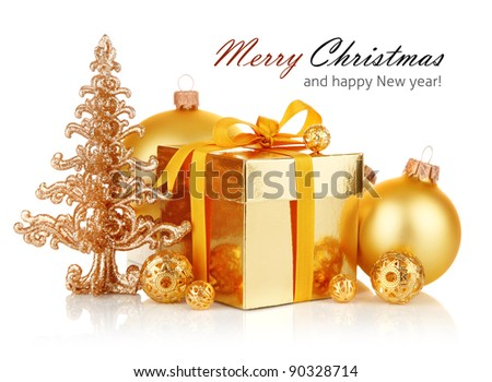 gold christmas gift with balls isolated on white background - stock photo