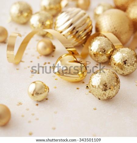 gold christmas ornaments, seasonal decoration - stock photo