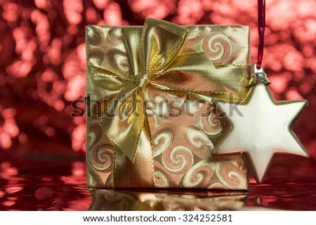 Gold Christmas present and star shaped ornament