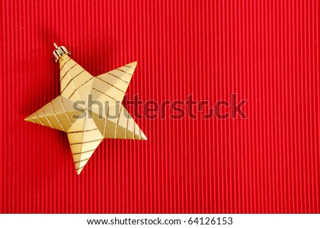 Gold Christmas star over red background. Xmas Card - stock photo