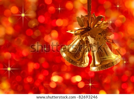 Gold Christmas tree decorations on lights background - stock photo