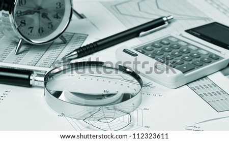 gold clock and office supplies on the table - stock photo