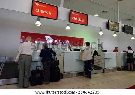 GOLD COAST, AUS - NOV 22 2014:Passengers in Virgin Australia Airlines check in desk.It is Australia's second-largest airline as well as the largest by fleet size to use the Virgin brand. - stock photo