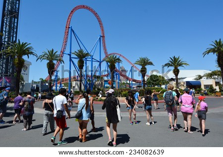 GOLD COAST, AUS -  NOV 06 2014:Visitors in Movie World Gold Coast Queensland Australia.The park opened in 1991 and contains various movie-themed rides and attractions. - stock photo