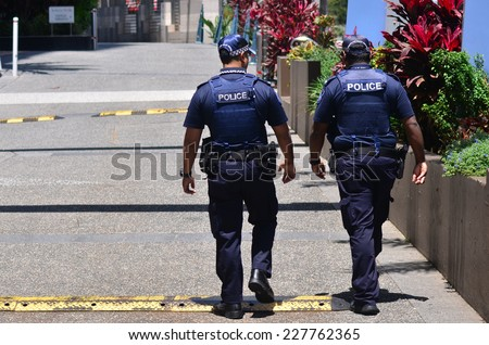 GOLD COAST, AUS - OCT 28 2014:Police officers patrols in Surfers Paradise. Gold Coast police on high terror alert warned to be hyper vigilant and patrol local mosques and critical infrastructure sites - stock photo