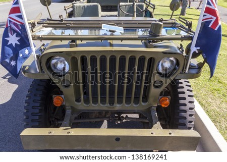 GOLD COAST, AUSTRALIA - APRIL 25 :Two WW II Jeep at the Memorial Service with War Veterans Remembers Anzac Day on March April 25, 2013 in Gold Cost , Australia. - stock photo