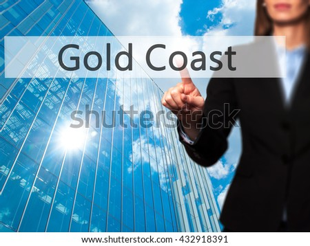 Gold Coast - Businesswoman hand pressing button on touch screen interface. Business, technology, internet concept. Stock Photo
